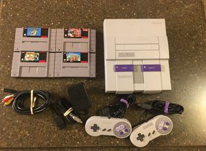 Super Nintendo Bundle with 4 Games, Mario World, Mario Kart and more for Sale in Towson, MD