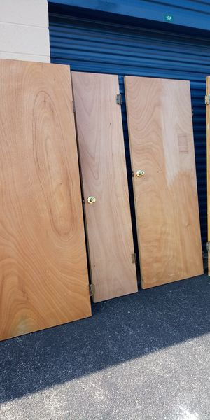 4 door interior door lot all must go together spme holes in doors for Sale in Newport News, VA