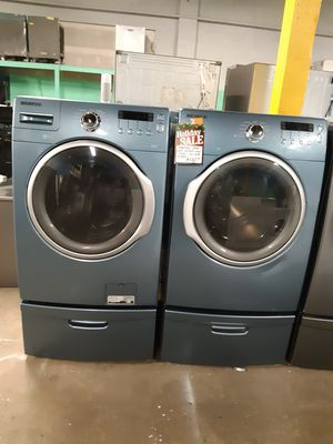 SAMSUNG FRONT LOAD WASHER AND DRYER SET WITH PEDESTAL WORKING PERFECTLY 4 MONTHS WARRANTY for Sale in Baltimore, MD