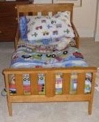 Solid wood toddler bed frame - includes bedding set with truck pattern! for Sale in Chicago, IL