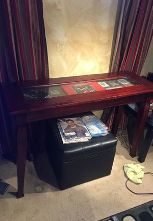 Glass top console table with display. Matching coffee table 20. for Sale in Portland, OR