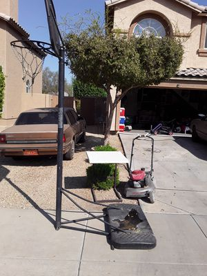 Basketball hoop table granted and a lawn mower Honda missing two wheels it does start but it I use it for parts for Sale in Glendale, AZ
