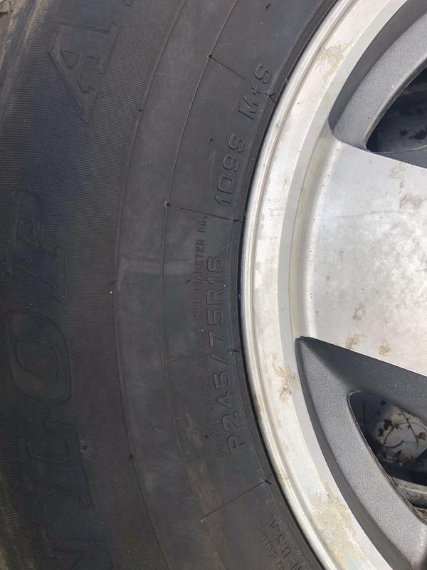 Factory Chevy Rim New Tires Off Suburban