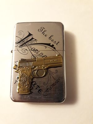New etched golden pistol gun windproof oil lighter similar to zippo for Sale in Lancaster, OH