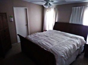 King size Pier1 sleigh bedroom set with used mattress and Stern and Foster box spring for Sale in Tampa, FL