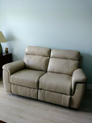 "Moving Sale! Gently used, leather loveseat, double recliner. It measures 65"" L x 36"" D. One seat has electric power one manual power. for Sale in Delray Beach, FL"