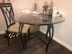 Glass, round dining table with 2 chairs for Sale in Houston, TX