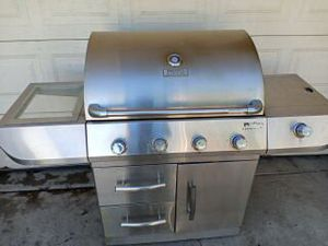 Stainless steel Gas propane BBQ grill four burner...works great in good condition ready to BBQ already been clean I'm located in Hesperia be CA for Sale in Hesperia, CA
