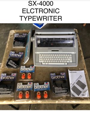 ELECTRIC TIPEWRITER WITH BRAND NEW ACCESORIES for Sale in Los Angeles, CA