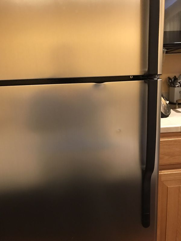 Refrigerator with small dent . Perfect for garage or basement