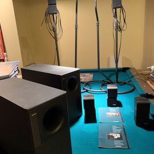 Bose surround sound speaker system with stands for Sale in Traverse City, MI