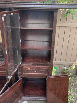 Free Solid Wood With Glass Cabinets for Sale in Tustin,  CA