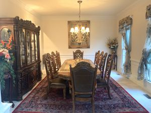 Beautiful traditional dining table with 10 chairs for Sale in Manassas, VA