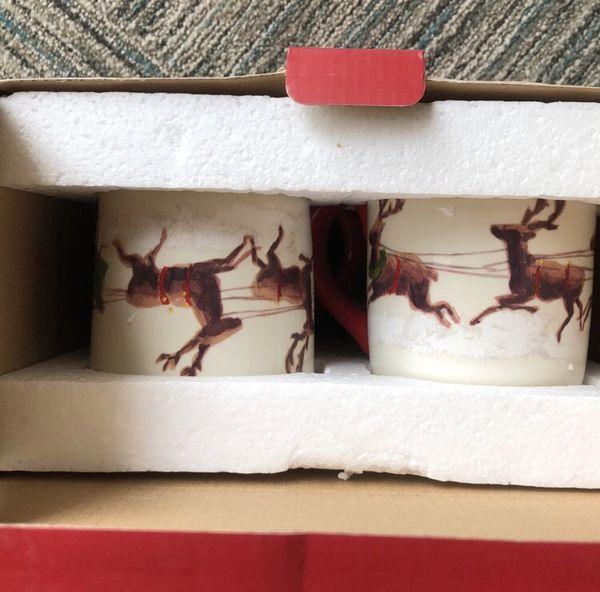 williams-sonoma Christmas santa and reindeer set of four mugs with box.