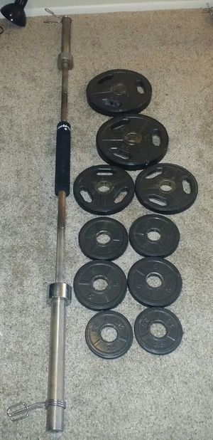 """Olympic 2"""" weights with rubber around them. 2x25lbs, 2x10lbs, 4x5lbs, 2x2.5lbs. 7 foot 45lb Olympic barbell and squat cushion. 2 weight locks. for Sale in Deerfield Beach, FL"""