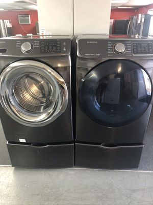 Used Samsung high efficiency front load washer and dryer set. 1 year warranty for Sale in St. Petersburg, FL