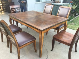 Dining table come with six chairs in very good condition. Four chairs is leather and two solid wood. for Sale in Fresno, CA