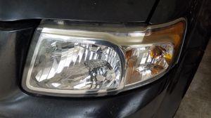 08 Mazda tribute headlight for Sale in Rockford, IL
