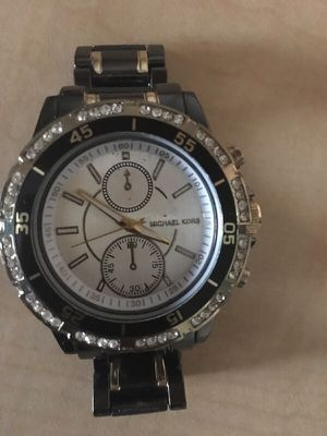 Michael Kors watch (Black & Gold) for Sale in Baltimore, MD