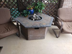 Fire pit patio table with 4 chairs and cushions for Sale in Saginaw, TX