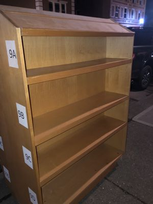 Double sided book shelf on wheels for Sale in Franklin, OH