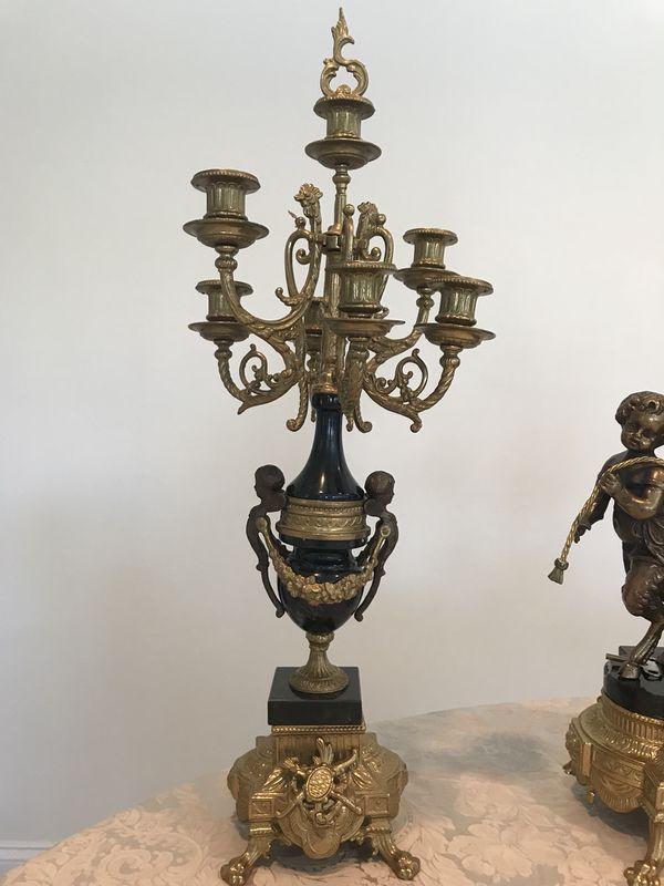 Antique brass clock and candelabra