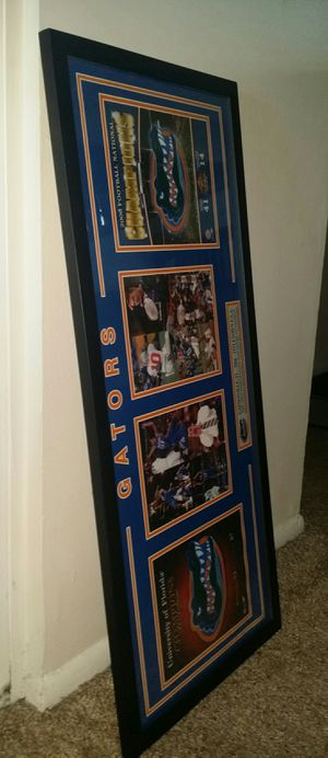 "Florida Gators collectible Photo frame of college football and basketball 2006 championships. 38"" wide x 17"" height. for Sale in Pompano Beach, FL"