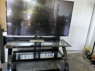52inch Philips 4k Ultra Hd With TV Stand for Sale in Poinciana,  FL