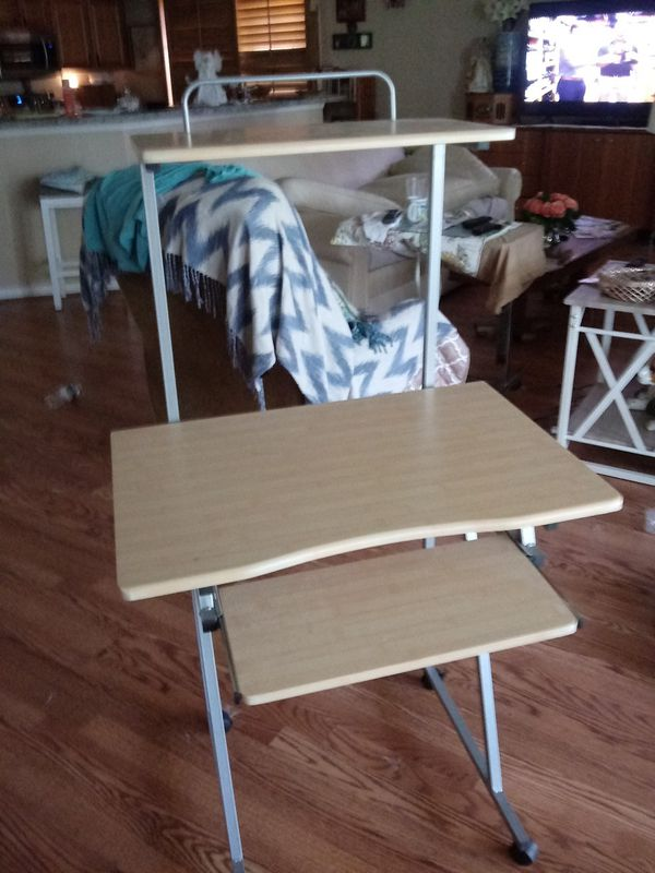 Desk on wheels top shelf and pull out shelf light oak. wood with silver New on amazon for 70 unassembled i assembled it so not return pd 70 asking 35
