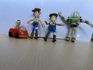 Vintage Toy Story collectibles. Buzz Lightyear, Woody, woody with backpack, and Barbie in car. for Sale in El Paso, TX