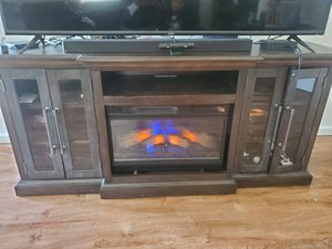 72 inch TV stand with Fire place. for Sale in Fresno, CA