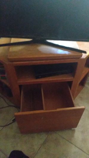 Corner shaped t.v stand plus storage. Heavy solid wood. for Sale in El Cajon, CA
