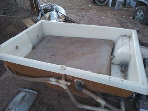 Jacuzzi. not huge ,but larger than a motel tub. comes with cover and reinforced plywood 'skid'(?),to go underneath it /with casters under it. for Sale in Yuma, AZ