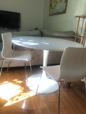 White circular table with two matching chairs for Sale in New York, NY