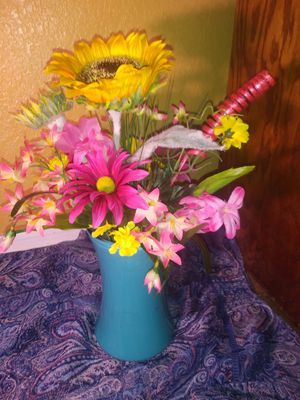 Beautiful turqoise glass vase with bright flowers for Sale in Mesa, AZ