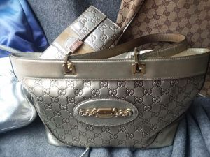 Authentic Gucci Guccissima Gold leather purse / matching wallet for Sale in Tarpon Springs, FL