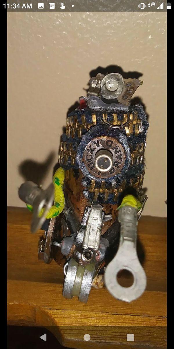 2 inch mini scrap metal robot made of computer parts and brass Jean revets