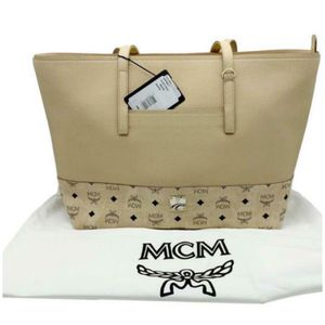 Mcm authentic women's handbag brand new with tags and dust bag for 490$ only great deal retails for 950$ plus taxes perfect Christmas gift for Sale in Bellevue, WA