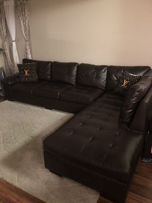 Leather sectional couch with area rug and Lv pillows for Sale in Alexandria, VA