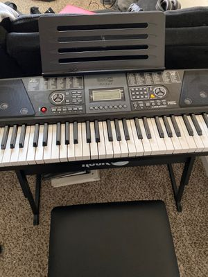 Rockjam Keyboard with seat and detachable music stand for Sale in Fresno, CA