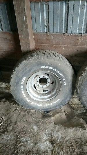 "35"" tires on 16.5"" 8 bolt Chevy rims for Sale in Trempealeau, WI"