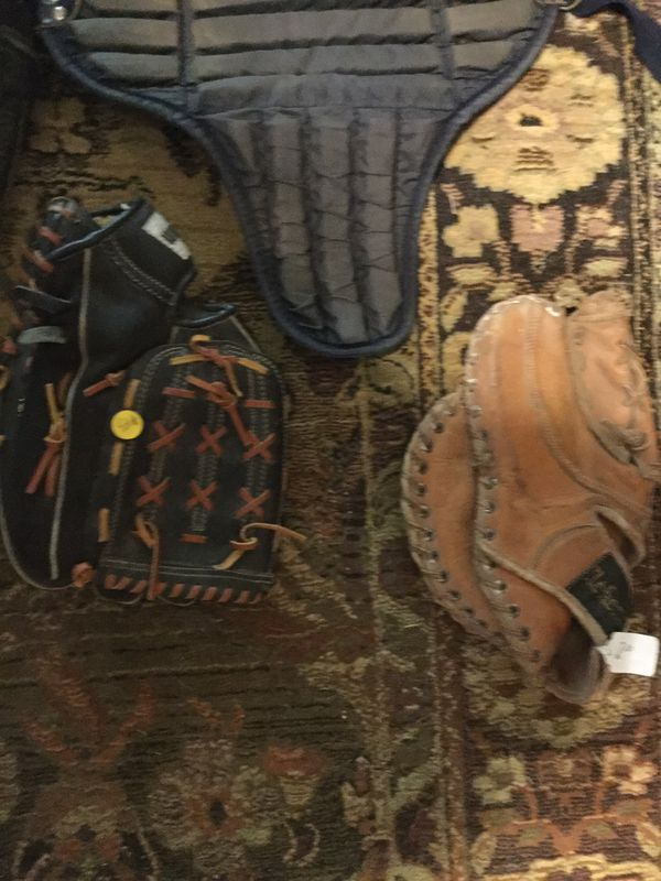 Baseballs gloves and catchers gear