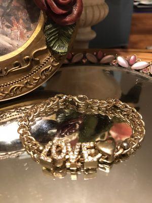 Pretty!!! Gold Love Bracelet with Diamond Crystal Stones for Sale in Gainesville, VA