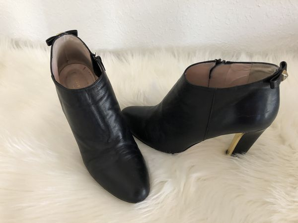 511fc44e43 KATE SPADE New York Black Leather Netta Booties with Gold Accents and Bow  on Back Of Heel Top