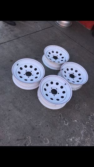 Set of 15x5 White with Red/Blue stripe steel rims 5/4.5 for trailers, in great shape. No dents or bents for Sale in South El Monte, CA
