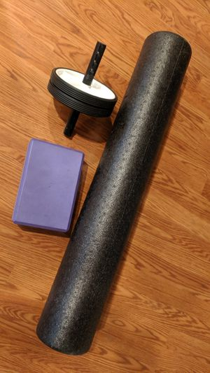 Assorted health goods, yoga block, an roller, and body roller for Sale in Southborough, MA