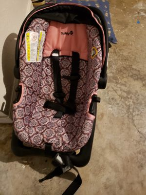 Car seat and bag full of baby girl items for Sale in Palm Coast, FL