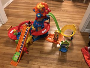 V-Tech GOGO Smart Car play sets and a bunch of track for Sale in Fort Worth, TX