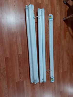 2 fluorescent light fixtures with 2 lights on each and two additional 40w. Bulbs. 48 inches for Sale in Tampa, FL