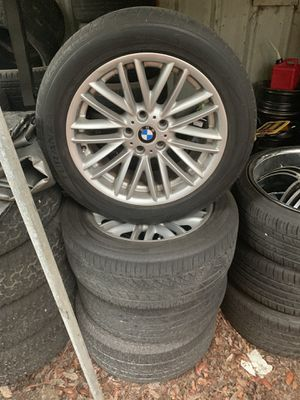 2003 BMW 745i rims and tires for Sale in Tampa, FL